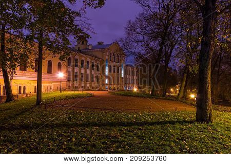 Night view of park lawn and building of State University of Communication in Yusupov Garden Saint Petersburg Russia