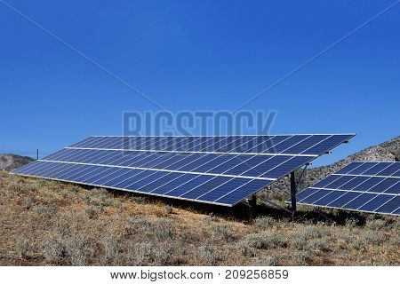 Solar panels under sunny blue sky. Greece.