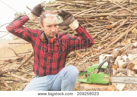 Lumberjack preparing to cut some wood for the winter.