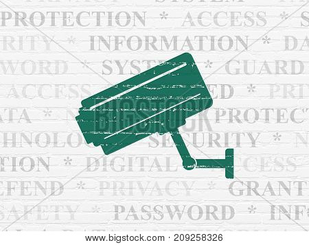Security concept: Painted green Cctv Camera icon on White Brick wall background with  Tag Cloud
