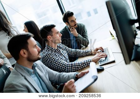 Young businesspeople working on computer in modern office