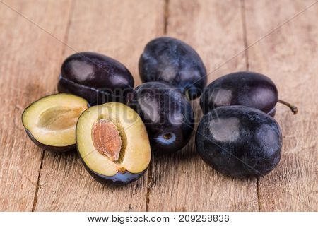 plum on a wooden table