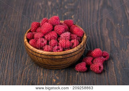 ripe raspberry on a wooden table