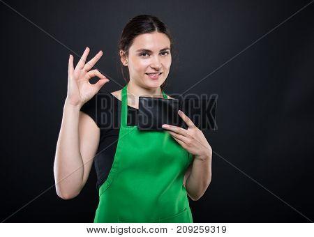 Attractive Girl Seller Doing Okay Gesture Sign