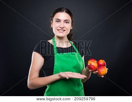 Pretty Female Clerk Presenting Her Fresh Merchandise