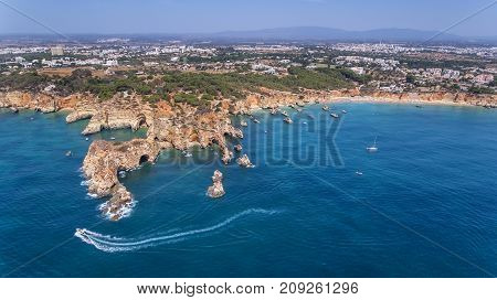 Aerial. View from the sky of the coast of Portimao. Beaches Submarino, and praia Joao de Arens.