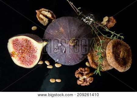 Figs, Dried Figs, Half Of Fig, Walnut And Pine Nuts On Black Background. Dieting Healthy Eating Conc