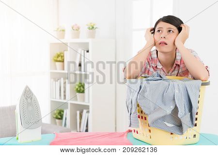 Beautiful Lady Using Iron Sort Out Family Clothes
