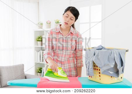 Attractive Mother Doing Housekeeping Very Tired