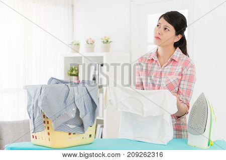 Student Girl Standing In Front Of Ironing Board