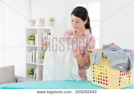 Mother Looking At White Shirt Feeling Satisfaction