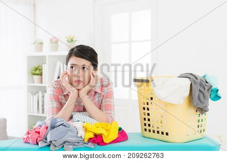 Unhappy Attractive Woman Maid Folding Clothes