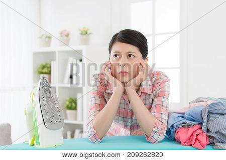 Elegant Housewife Ironing Clothing Feeling Boring