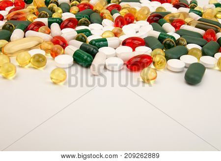 Pills Background. Heap Of Assorted Various Medicine Tablets And Pills Different Colors On White Back