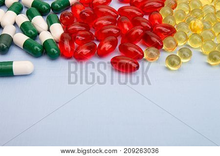Pills Background. Heap Of Medicine Tablets And Pills In Blisters Different Colors On Blue Background