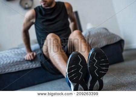 Man Doing Exercises In Bedroom