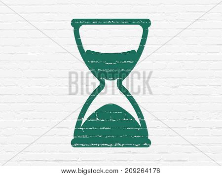 Timeline concept: Painted green Hourglass icon on White Brick wall background