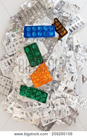 Heap Of Empty Assorted Various Medicine Tablets Pills Blisters Different Colors On White Background.