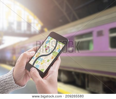 using smart phone with map gps navigation application. concept guideline street travel