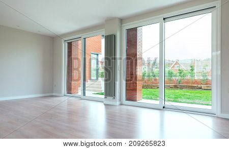 Large living room with large windows overlooking the garden