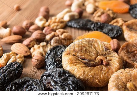 Dried Fruits And Nuts: Prunes, Apricots, Figs, Hazelnuts, Almond, Cashew, Walnut, Peanuts Over On Ol