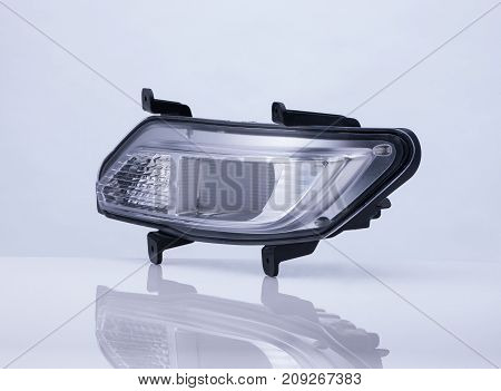 A Car Headlight On White Background With Reflection