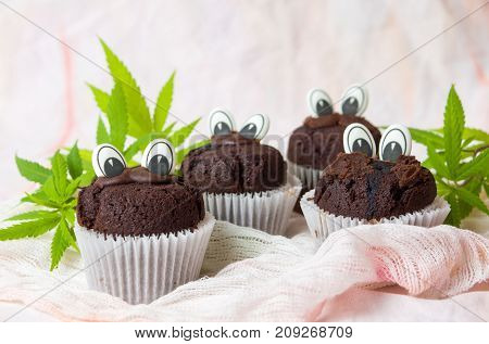 Chocolate Muffins With Edible Eyes And Marijuana Leafs