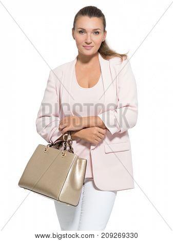 Portrait of an pretty adult  woman with handbag posing at studio