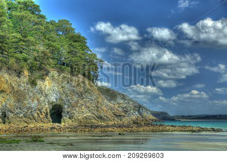 HDR image - entrance to a sea grotto at low tide Morgat Crozon peninsula Finistere Brittany France