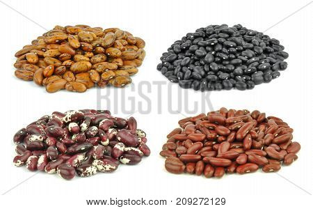 Beans - black, yellow, red pointed pinto beans isolated on white background