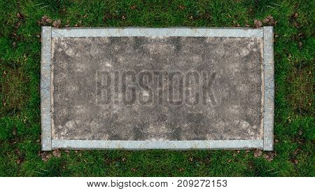 Board for text from asphalt road, along the edges of the border of stone, green grass fall in city. Background for the inscription autumn spring style in nature.