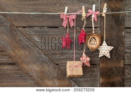 Rustic wooden christmas background with festive ornaments