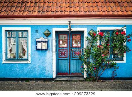YSTAD SWEDEN - JULY 28 2015: Colorful house at summer day in idyllic village Ystad Sweden