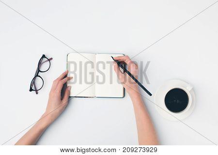 Writing In Notebok