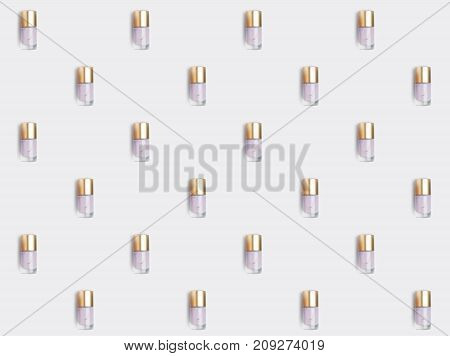 close up of repetitive pattern of nail polish bottles