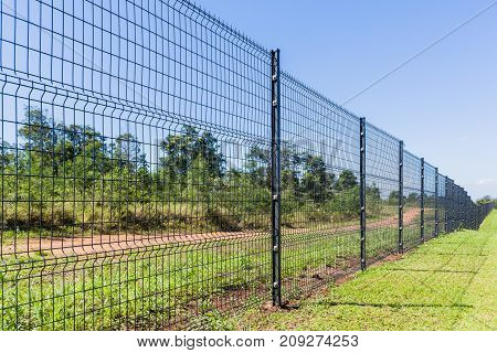 Boundary Fence steel erected on property in countryside landscape.