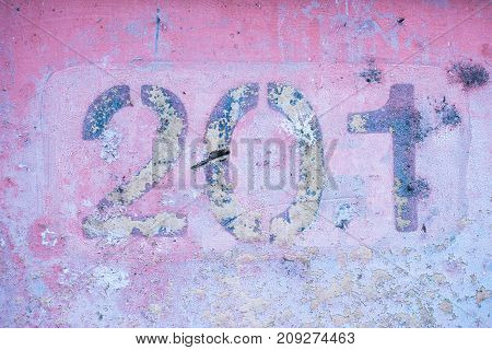 number 2 0 1 on a pink wall, two hundred and one.