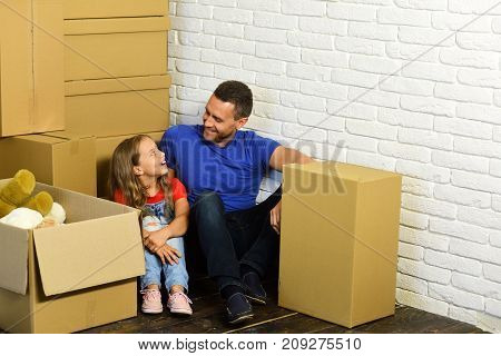 Home And Family Concept. Girl And Man With Smiling Faces
