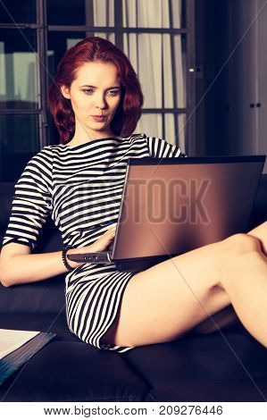 Red-haired Young Business Woman Or Student Girl Working With Com