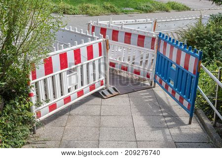Warning Fences On A Pavement