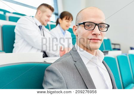 Young man as medical school student learn medicine studies in seminar