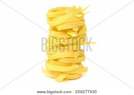 Tagliatelle nests, pasta isolated on white background
