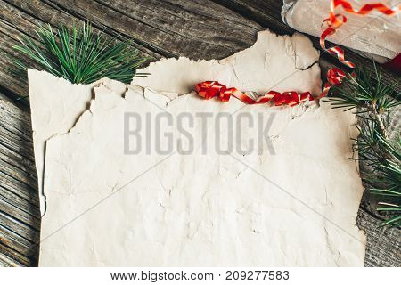 Old Crumpled Paper And Christmas Tree Branches