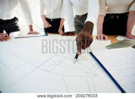 Group of detective agents discussing sketch of crashed airplane