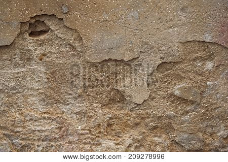 Background and texture of rough and broke brown cement wall.