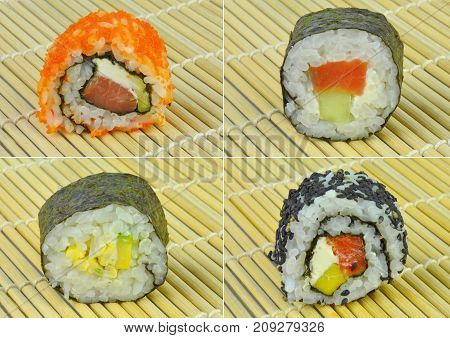Sushi rolls set on bamboo mat background