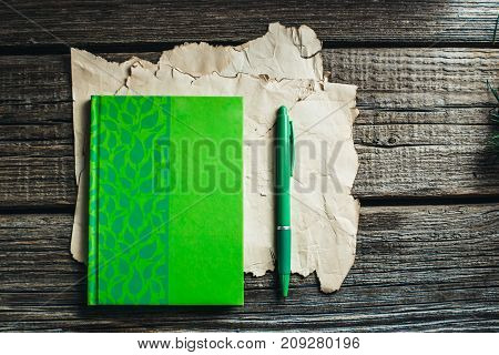 On The Old Wooden Table Located Items, Notebook, Pen
