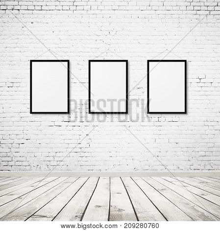 Vintage room interior with three photo frames over white brick wall and wood floor background