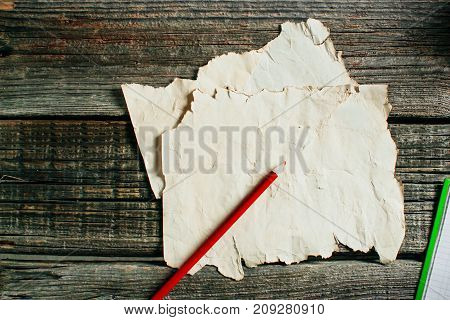Old Paper Sheet On Aged Wooden Wall