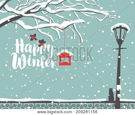 Vector winter scene at the snow-covered park with calligraphic inscription Happy Winter with branches of a tree bullfinches and a bird feeder a street lamp and a cat on the fence in the snow
